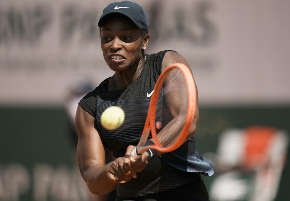 United States's Sloane Stephens plays a return to Czech Republic's Barbora Krejcikova during their fourth round match on day 9, of the French Open tennis tournament at Roland Garros in Paris, France, Monday, June 7, 2021. (AP Photo/Thibault Camus)