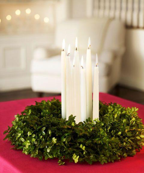 "<p>This easy-to-make candle wreath is classic for the holidays.</p><p>See more at <a href=""http://www.goodhousekeeping.com/holidays/christmas-ideas/how-to/g2203/christmas-decoration-ideas/?slide=6"" rel=""nofollow noopener"" target=""_blank"" data-ylk=""slk:Good Housekeeping"" class=""link rapid-noclick-resp"">Good Housekeeping</a>. </p>"