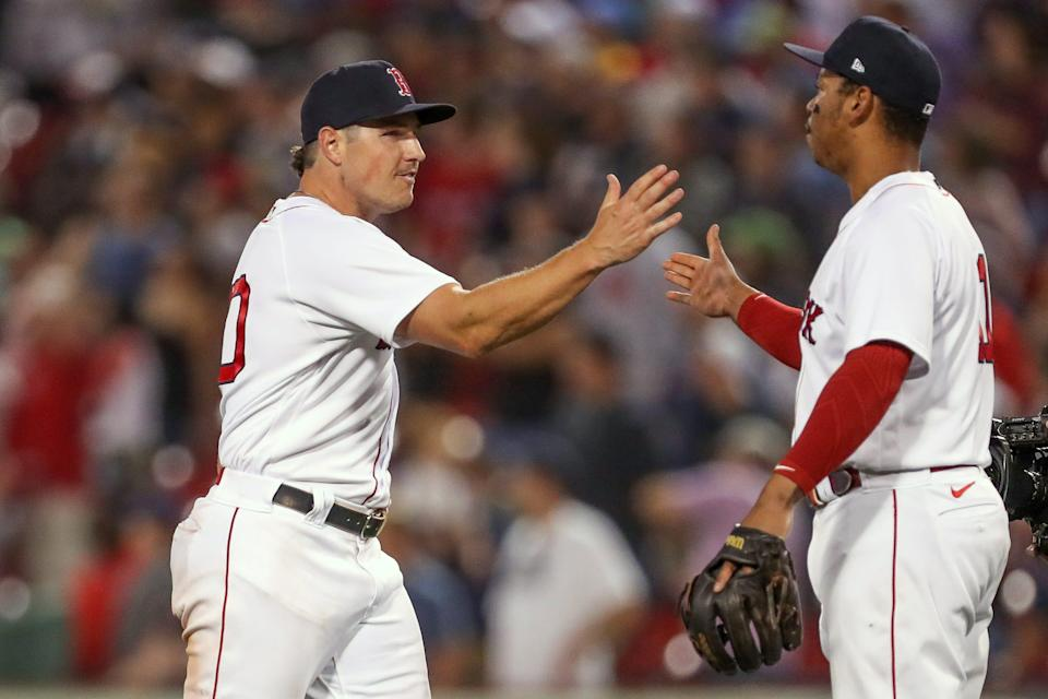Red Sox outfielder Hunter Renfroe, left, and third baseman Rafael Devers celebrate Wednesday's win over Tampa Bay Rays that moved Boston into the AL's top wild-card playoff spot.