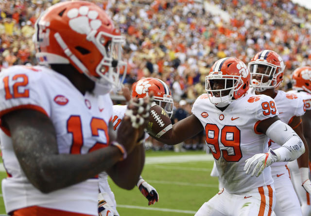 Clemson defensive end Clelin Ferrell (99) celebrates with team mates after falling on a Georgia Tech fumbled ball in the end zone for touchdown during the first half of an NCAA college football game, Saturday, Sept. 22, 2018, in Atlanta. (AP Photo/Mike Stewart)