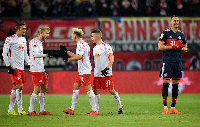 Soccer Football - Bundesliga - RB Leipzig vs Bayern Munich - Red Bull Arena, Leipzig, Germany - March 18, 2018 RB Leipzig's Kevin Kampl, Diego Demme and team mates celebrate after the match REUTERS/Matthias Rietschel DFL RULES TO LIMIT THE ONLINE USAGE DURING MATCH TIME TO 15 PICTURES PER GAME. IMAGE SEQUENCES TO SIMULATE VIDEO IS NOT ALLOWED AT ANY TIME. FOR FURTHER QUERIES PLEASE CONTACT DFL DIRECTLY AT + 49 69 650050