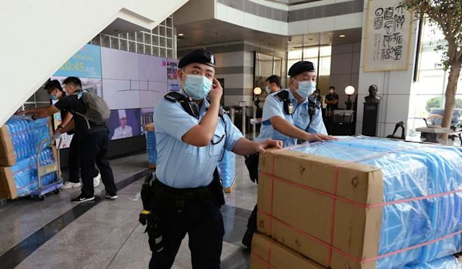 Hong Kong police conduct a raid of the offices of the Apple Daily newspaper after arresting its founder Jimmy Lai on Monday morning. His two sons and some of the newspaper's senior executives were also taken into custody. Photo: Handout
