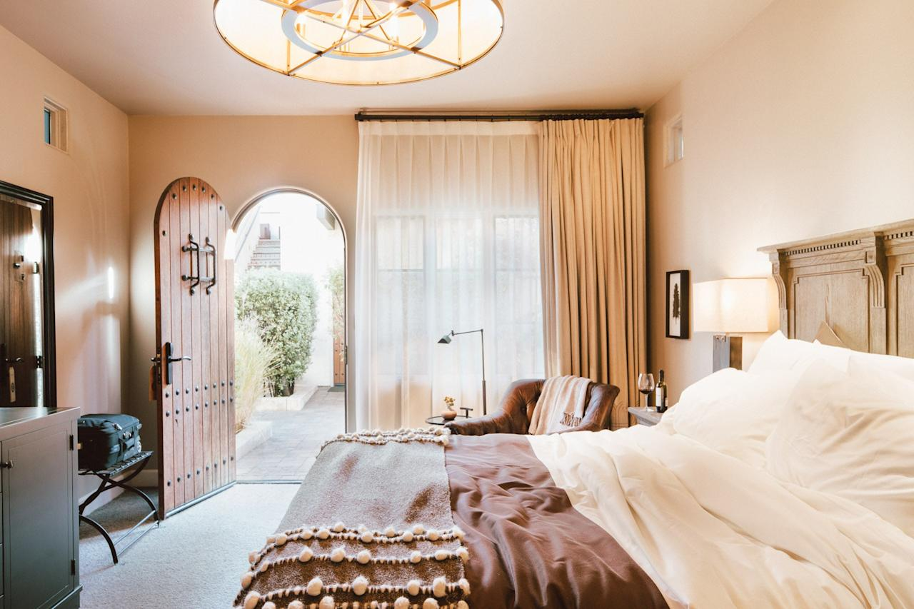 In many ways, Yountville's North Block Hotel is the anti-boutique hotel: There are few gimmicks at this Mediterranean-inspired stucco-and-stone stay. Instead, its draws are its laidback, sophisticated style, its top-tier service, and its proximity to the wining and dining of downtown Yountville. Hidden behind plantation-style shutters and breezy archways, the spare, smartly-done lobby sports no space for live musical performances or fierce face-offs at leather-upholstered pool tables, and its 20 rooms, situated around a central outdoor courtyard, are equally simple and well-appointed. Try to book a suite on the second floor for prime views of the rolling Napa Valley hills. At the on-site spa by Francis & Alexander, the Un-Corked treatment—a foot and back exfoliation massage that uses wine corks to stimulate reflex points—is an effective (if a little kooky) revelation. Grab a bite on-site at Redd Wood, an upscale osteria-styled eatery by James Beard Award nominee Richard Reddington, where wood-fired pizzas and charcuterie platters are the order of the day.