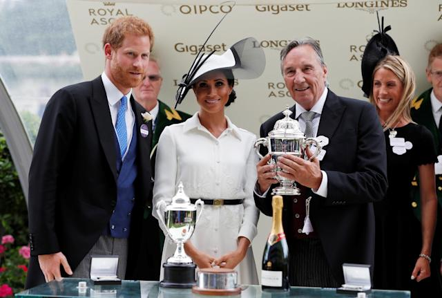 Horse Racing - Royal Ascot - Ascot Racecourse, Ascot, Britain - June 19, 2018 Britain's Prince Harry and Meghan, the Duchess of Sussex look on during a trophy presentation Action Images via Reuters/Paul Childs