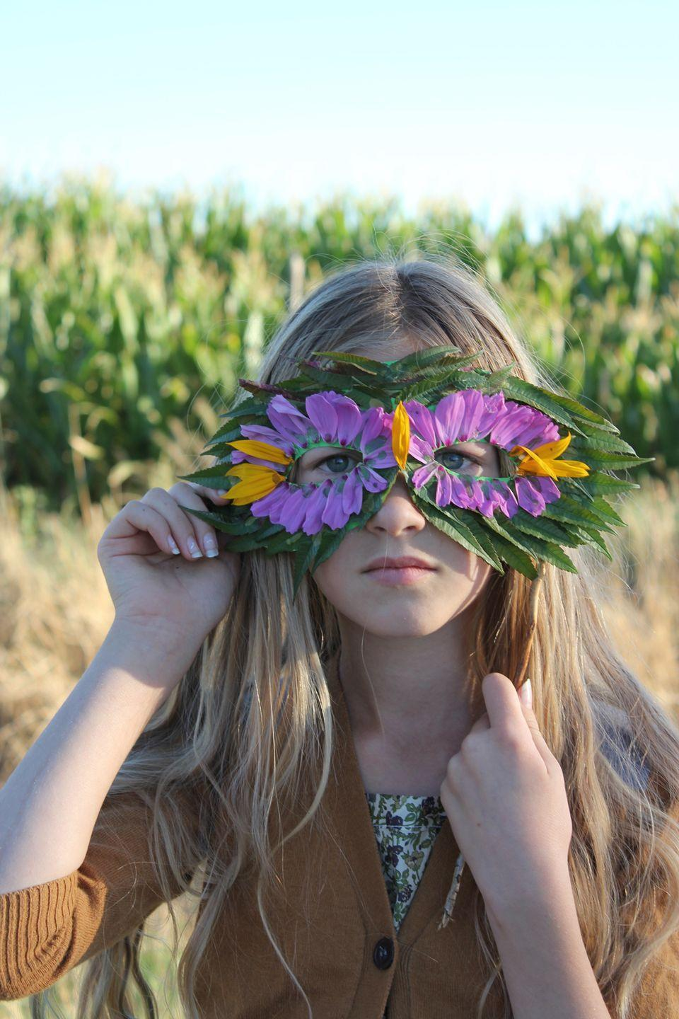 """<p>Your child will certainly feel one with nature once they put together with nature-themed mask, which can easily be made with flowers, leaves, and some glue. </p><p><strong><em>Get the tutorial at <a href=""""http://mermagblog.com/diy-nature-mask-with-leaves-and-flowers/"""" rel=""""nofollow noopener"""" target=""""_blank"""" data-ylk=""""slk:Mer Mag"""" class=""""link rapid-noclick-resp"""">Mer Mag</a>. </em></strong></p>"""