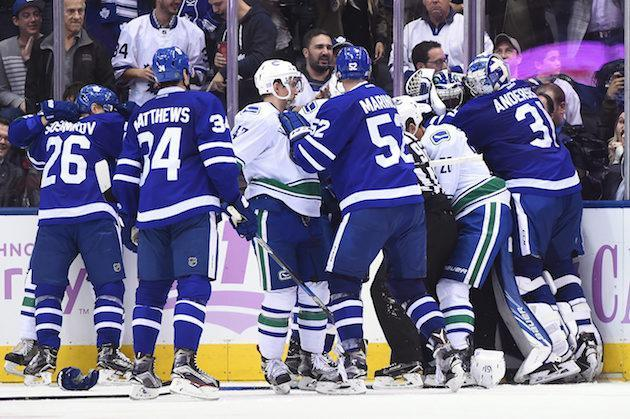 Vancouver Canucks and Toronto Maple Leafs players brawl during the third period of an NHL hockey game Saturday, Nov. 5, 2016, in Toronto. (Frank Gunn/The Canadian Press via AP)