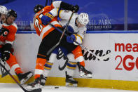 Buffalo Sabres forward Jeff Skinner (53) is checked by Philadelphia Flyers forward Scott Laughton (21) during the second period of an NHL hockey game, Sunday, Feb. 28, 2021, in Buffalo, N.Y. (AP Photo/Jeffrey T. Barnes)