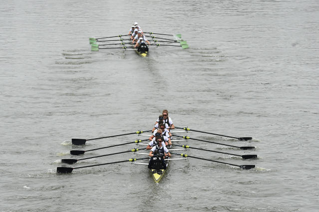 Cambridge, top, hold a significant lead on the Oxford boat during the Women's Boat Race on the River Thames in London, Sunday April 7, 2019. Cambridge went on to win the annual Women's Boat Race traditionally fought out between Oxford and Cambridge university rowing crews. (Kirsty O'Connor/PA via AP)