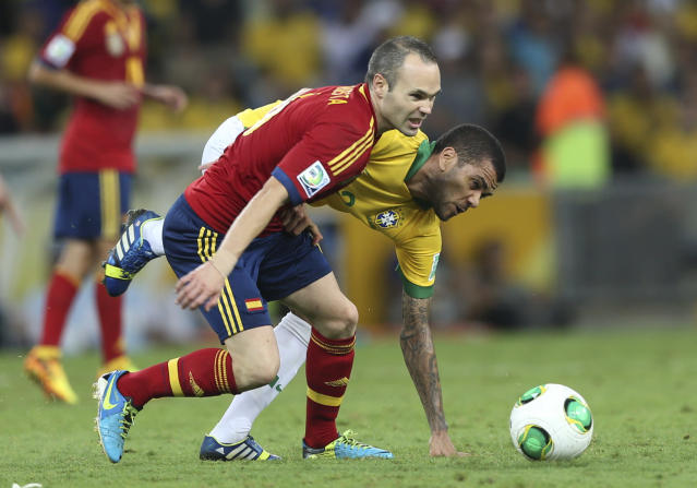 FILE- In this June 30, 2013, file photo, Spain's Andres Iniesta, front, and Brazil's Dani Alves battle for the ball during the soccer Confederations Cup final at the Maracana stadium in Rio de Janeiro, Brazil. (AP Photo/Andre Penner, File)