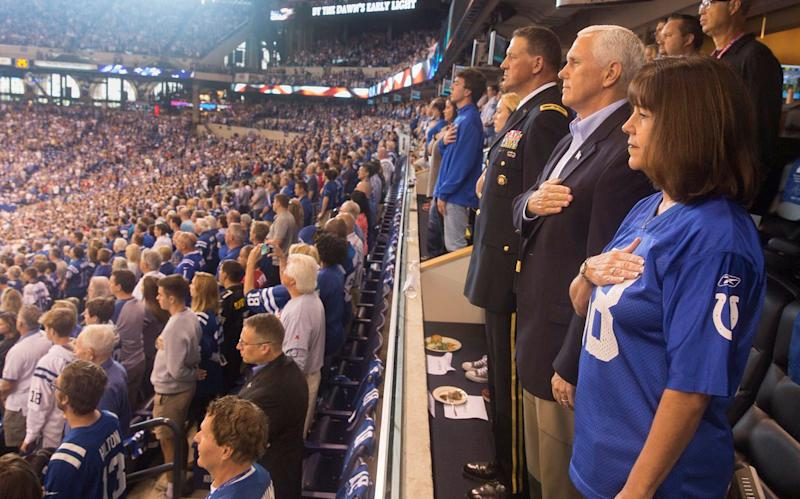 Vice President Mike Pence and second lady Karen Pence stand during the national anthem prior to the start of an NFL football game between the Indiana Colts and the San Francisco 49ers at the Lucas Oil Stadium in Indianapolis, Oct. 8, 2017. (Social Media / Reuters)