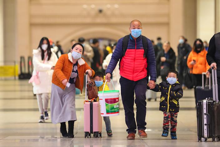 WUHAN, CHINA - JANUARY 21 2020: Passengers wearing protective masks walk inside Hankou Railway Station in Wuhan in central China's Hubei province Tuesday, Jan. 21, 2020. A new type of coronavirus has infected hundreds of people in the city.- PHOTOGRAPH BY Feature China / Barcroft Media (Photo credit should read Feature China / Barcroft Media via Getty Images)
