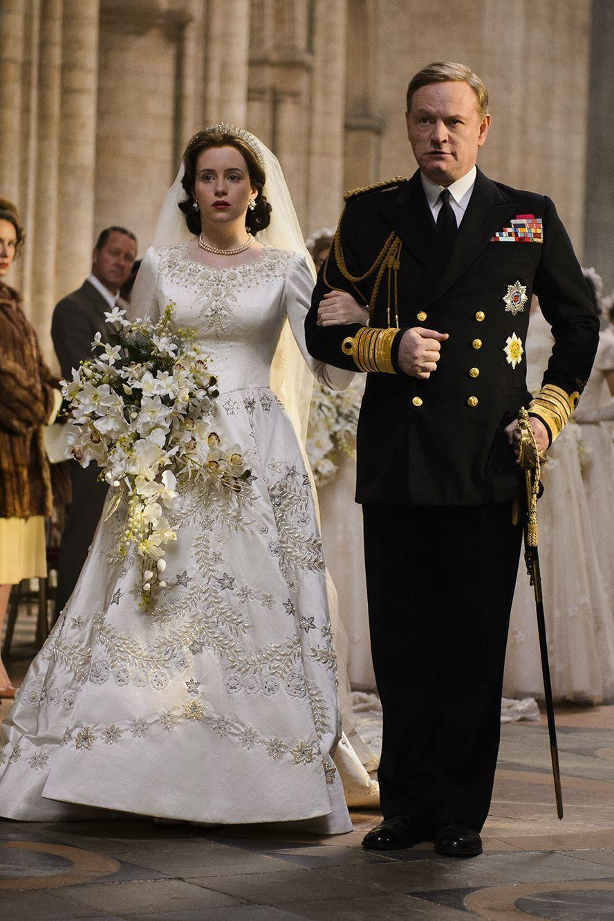 """<p>Season 1 costume designer Michele Clapton told <em>BAZAAR</em> Australia the queen's wedding gown was the """"most elaborate [and] time-consuming"""" costume. She told <a href=""""https://www.harpersbazaar.com/culture/film-tv/news/a19298/michele-clapton-the-crown-interview/"""" rel=""""nofollow noopener"""" target=""""_blank"""" data-ylk=""""slk:BAZAAR.com"""" class=""""link rapid-noclick-resp"""">BAZAAR.com</a>, """"I thought it was so important that it was as close as we could possibly make it. That whole procession with the bridesmaids and the train and everything was something which I though, 'If we don't get that right, then we don't actually have the right to make anything else up.'""""<br></p>"""