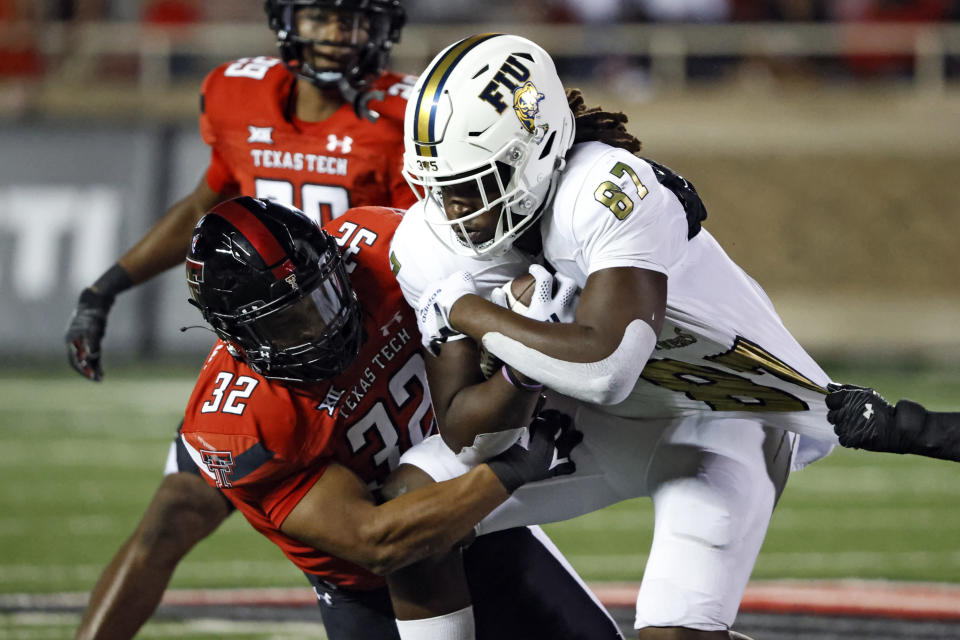 Texas Tech's Tyrique Matthews (32) tackles Florida International's Kamareon Williams (87) during the second half of an NCAA college football game on Saturday, Sept. 18, 2021, in Lubbock, Texas. (AP Photo/Brad Tollefson)