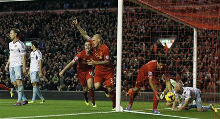 Liverpool's Martin Skrtel (C) celebrates after his team scored during their English Premier League soccer match against West Ham United at Anfield in Liverpool,, northern England December 7, 2013. REUTERS/Phil Noble