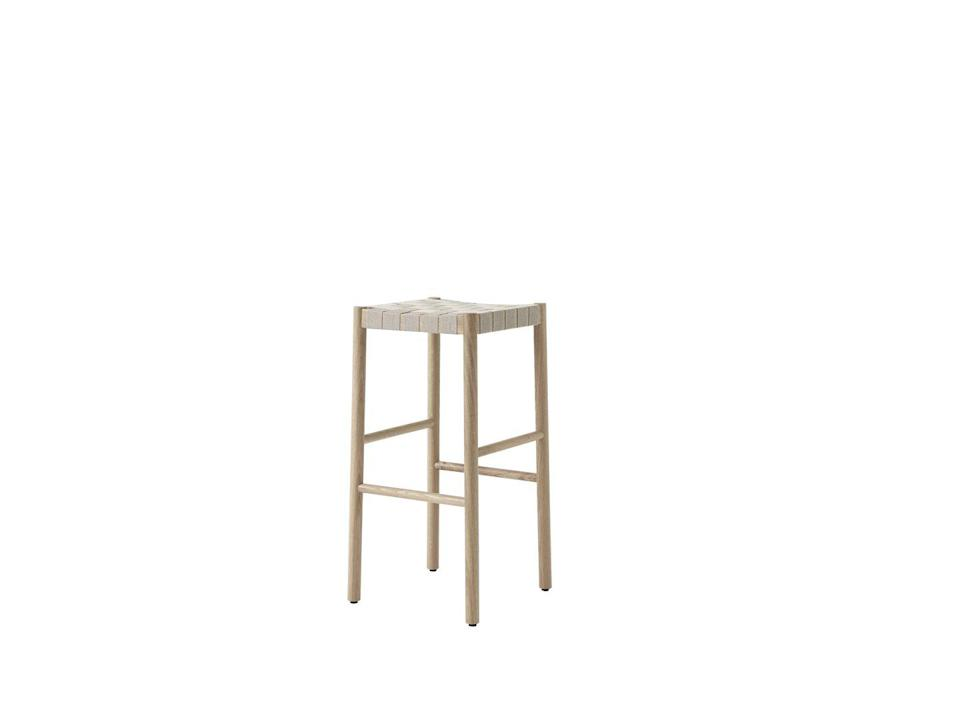 """<p>Named for the Betty Nansen theatre in Copenhagen, this understated stool by Danish-Finnish duo Thau & Kallio combines a lacquered oak frame with a webbed seat handwoven from natural linen fibres. Smartly, there's a stackable chair to match. £400, <a href=""""https://www.twentytwentyone.com/products/andtradition-thau-and-kallio-betty-tk8-barstool-2020"""" rel=""""nofollow noopener"""" target=""""_blank"""" data-ylk=""""slk:twentytwentyone.com"""" class=""""link rapid-noclick-resp"""">twentytwentyone.com</a></p>"""