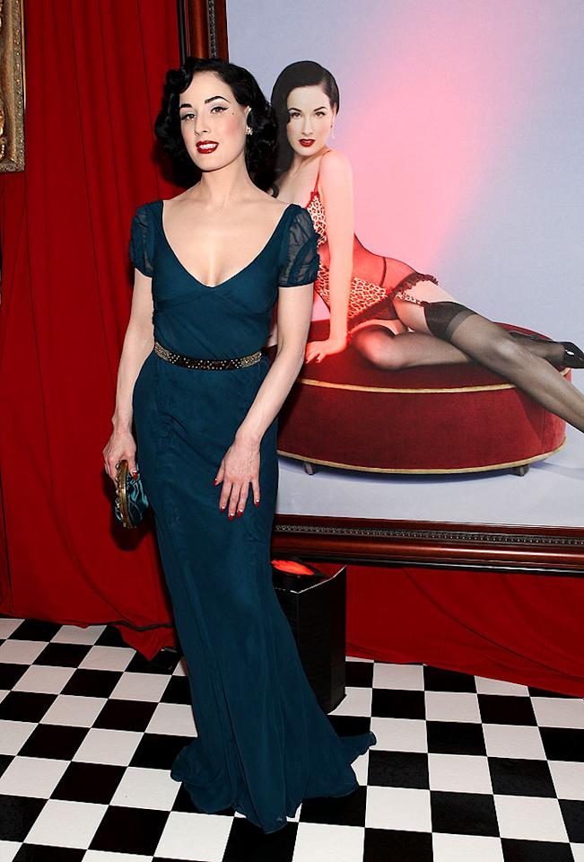 "Burlesque beauty Dita Von Teese poses with a photograph of herself. Jeff Vespa/<a href=""http://www.wireimage.com"" target=""new"">WireImage.com</a> - October 24, 2007"