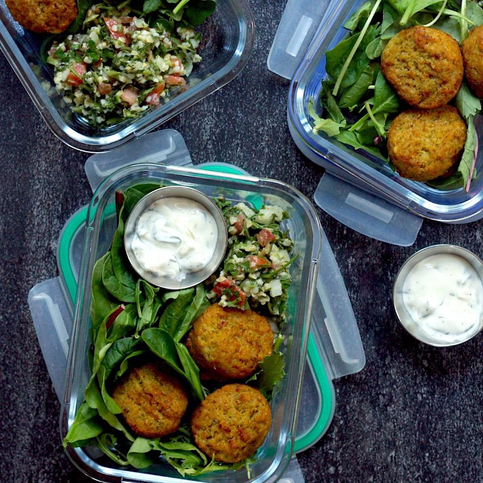 """<p>Meal-prepping a week's worth of lunches doesn't need to take hours in the kitchen. These Greek-inspired meal-prep bowls can be prepared in just 10 minutes and only require 4 ingredients--greens, falafel, tabbouleh and tzatziki. We love going to our local specialty grocery store for fast shortcut ingredients like these. The high-fiber falafel and tabbouleh will help to keep you feeling satisfied all afternoon. <a href=""""https://www.eatingwell.com/recipe/277767/falafel-tabbouleh-bowls-with-tzatziki/"""" rel=""""nofollow noopener"""" target=""""_blank"""" data-ylk=""""slk:View Recipe"""" class=""""link rapid-noclick-resp"""">View Recipe</a></p>"""