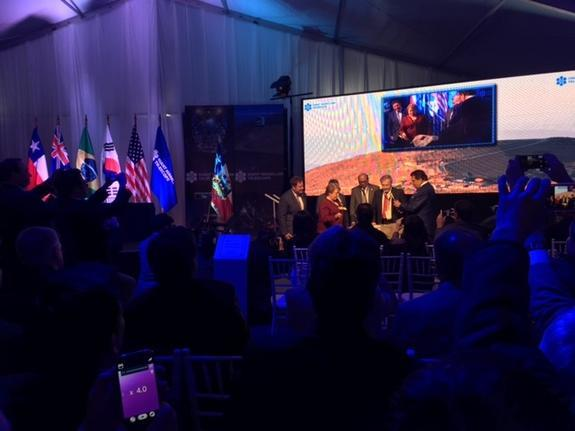 """Chilean President Michelle Bachelet hits a rock with a hammer at the groundbreaking ceremony for the Giant Magellan Telescope at Las Campanas Observatory on Nov. 11. (""""Las Campanas"""" means """"the bells"""" in Spanish; the observatory was named after"""