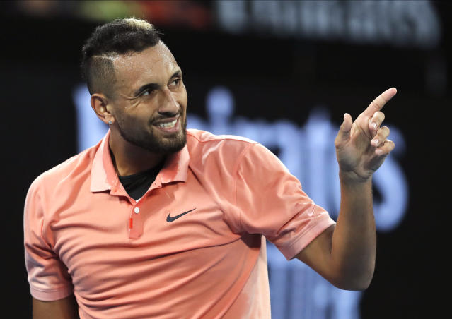 Australia's Nick Kyrgios gestures during his first round singles match against Italy's Lorenzo Sonego at the Australian Open tennis championship in Melbourne, Australia, Tuesday, Jan. 21, 2020. (AP Photo/Andy Wong)