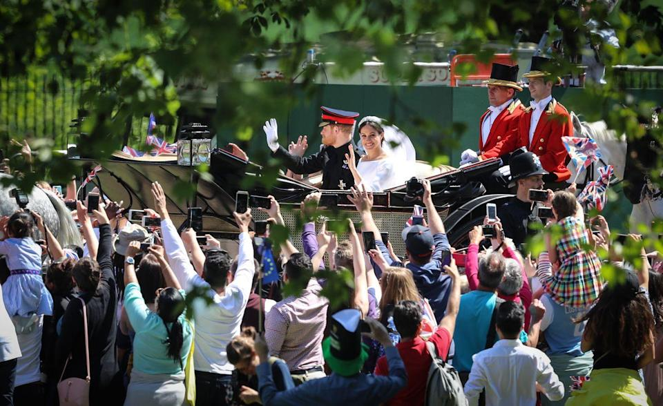 <p>A rare glimpse at the crowd during Harry and Meghan's carriage procession. </p>