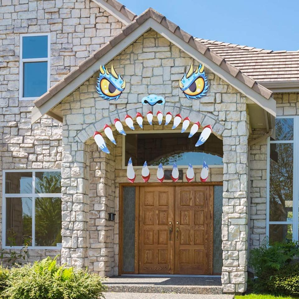 "<p>This <a href=""https://www.popsugar.com/buy/Unomor-Halloween-Decoration-Garage-Door-Archway-Monster-Face-486640?p_name=Unomor%20Halloween%20Decoration%20Garage%20Door%20Archway%20Monster%20Face&retailer=amazon.com&pid=486640&price=15&evar1=savvy%3Auk&evar9=46570755&evar98=https%3A%2F%2Fwww.popsugar.com%2Fsmart-living%2Fphoto-gallery%2F46570755%2Fimage%2F46571014%2FUnomor-Halloween-Decoration-Garage-Door-Archway-Monster-Face&list1=shopping%2Camazon%2Challoween%2Challoween%20decor%2Coutdoor%20decorating&prop13=api&pdata=1"" rel=""nofollow"" data-shoppable-link=""1"" target=""_blank"" class=""ga-track"" data-ga-category=""Related"" data-ga-label=""https://www.amazon.com/Unomor-Halloween-Decoration-16-5inches-12-6inches/dp/B07RFQJ3VK/ref=pd_sbs_469_10?_encoding=UTF8&amp;pd_rd_i=B07RFQJ3VK&amp;pd_rd_r=3c329782-a8e8-400e-85d9-bc48905a3d54&amp;pd_rd_w=bGkYB&amp;pd_rd_wg=kBKSR&amp;pf_rd_p=1c11b7ff-9ffb-4ba6-8036-be1b0afa79bb&amp;pf_rd_r=PF37P4N25CCKT20196FZ&amp;psc=1&amp;refRID=PF37P4N25CCKT20196FZ"" data-ga-action=""In-Line Links"">Unomor Halloween Decoration Garage Door Archway Monster Face</a> ($15) is such a clever idea.</p>"