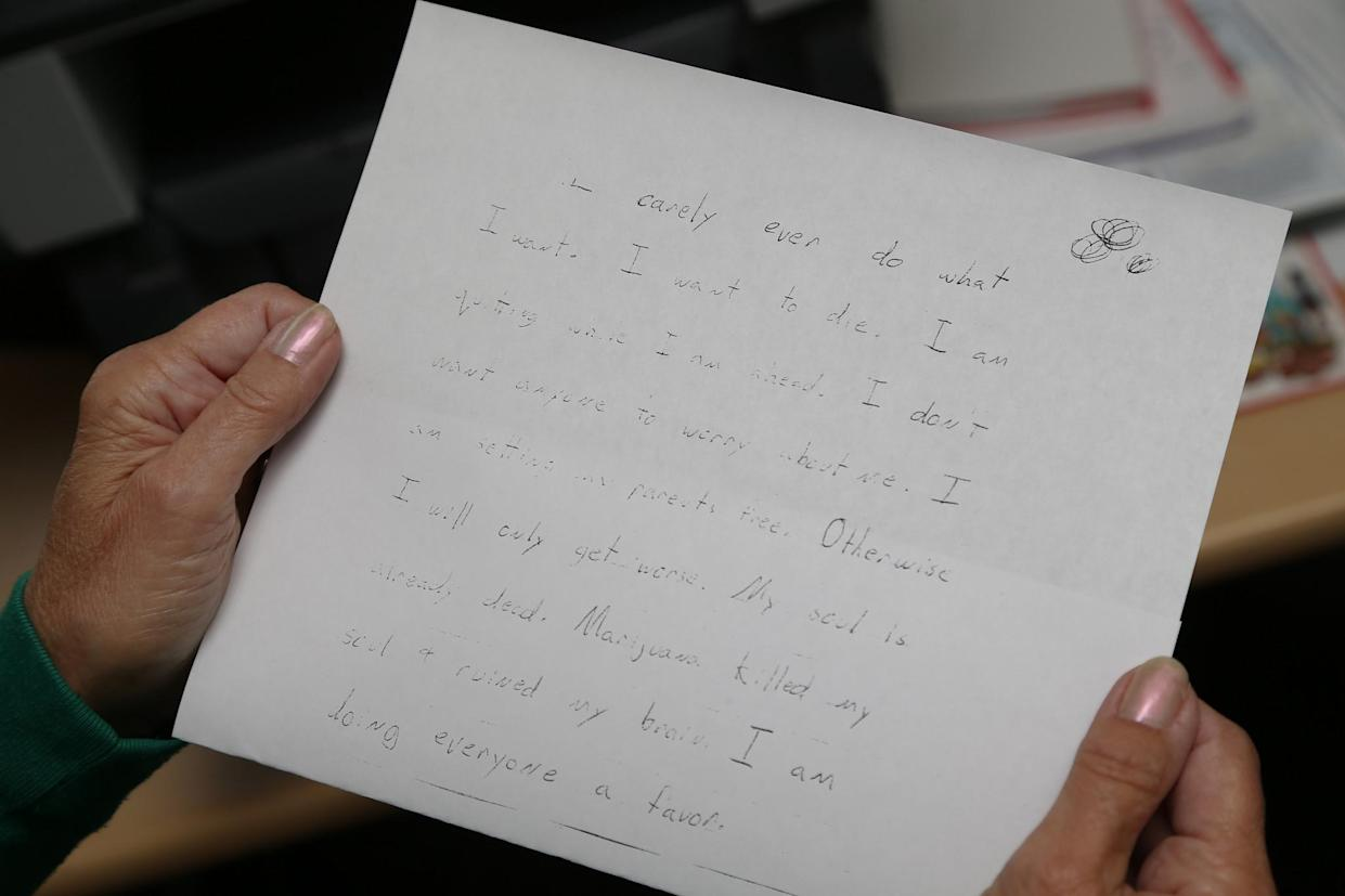 """Sally Schindel holds the suicide note photocopy of her sons handwriting at her home in Prescott, Ariz. on April 4, 2017. """"My soul is already dead. Marijuana killed my soul and ruined my brain. I am doing everyone a favor,"""" Zorn wrote. (Photo: Patrick Breen for Yahoo News)"""