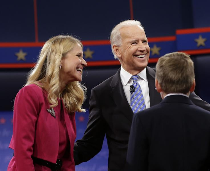 Vice President Joe Biden, right, with Janna Ryan, left, wife of Republican vice presidential candidate, Rep. Paul Ryan, R-Wis., after the vice presidential debate, at Centre College in Danville, Ky., Thursday, Oct. 11, 2012. (AP Photo/Pablo Martinez Monsivais)