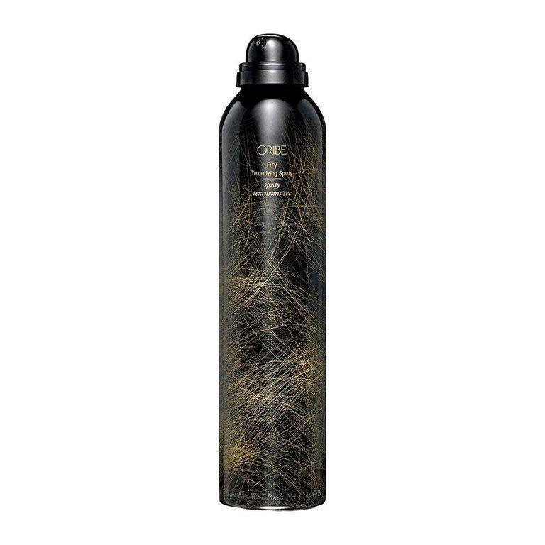 """<p><strong>Oribe</strong></p><p>amazon.com</p><p><strong>$48.00</strong></p><p><a href=""""https://www.amazon.com/dp/B003NXM9HS?tag=syn-yahoo-20&ascsubtag=%5Bartid%7C10058.g.33762832%5Bsrc%7Cyahoo-us"""" rel=""""nofollow noopener"""" target=""""_blank"""" data-ylk=""""slk:SHOP IT"""" class=""""link rapid-noclick-resp"""">SHOP IT</a></p><p>It's a sad day in our beauty routine when Oribe's Dry Texturizing Spray bottle runs empty. This stuff is a hairstyling <em>essential</em>. </p><p>This best-selling Amazon beauty product volumizes and thickens while adding hold and allover gritty texture. Sometimes we spray it at the roots in place of <a href=""""https://www.bestproducts.com/beauty/g104/oil-absorbing-dry-shampoos/"""" rel=""""nofollow noopener"""" target=""""_blank"""" data-ylk=""""slk:dry shampoo"""" class=""""link rapid-noclick-resp"""">dry shampoo</a>, sometimes we spray it all over strands after curling instead of hairspray, and sometimes we combine it with both, depending on the look we're going for. </p>"""