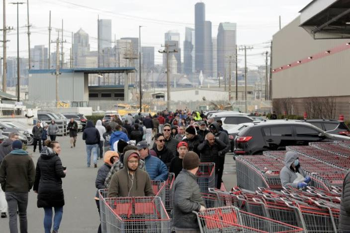 Shoppers line up at a Costco store, following reports of coronavirus disease (COVID-19) cases in the country, in Seattle