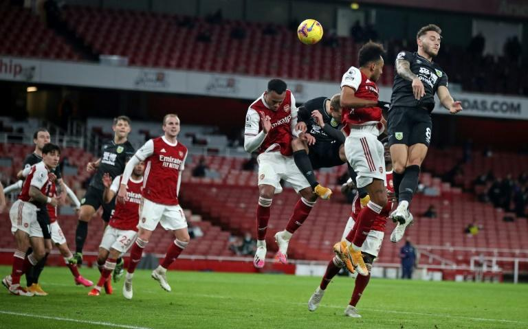 Pierre-Emerick Aubameyang (2nd R) heads the ball into his own net to gift Burnley a 1-0 Premier League win at Arsenal.