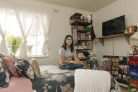 Alexandra Orozco sits in her bedroom where she runs her beauty company, Glossy Baby Cosmetics, in Delano, Calif., on Sunday, Dec. 6, 2020. She's currently making an estimated $200-300 per month in sales from her new online business, nearly five times less than her salary at J.C. Penney. (Madeline Tolle/The Fuller Project via AP)