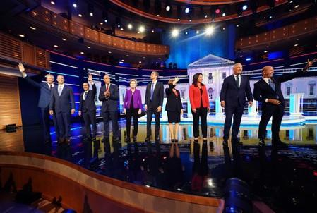 Candidates pose together before the start of the first U.S. 2020 presidential election Democratic candidates debate in Miami, Florida, U.S.,