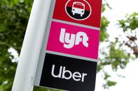FILE PHOTO: A sign marks a rendezvous location for Lyft and Uber users at San Diego State University in San Diego
