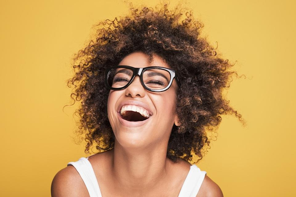 woman laughing on gold background, what do you call jokes