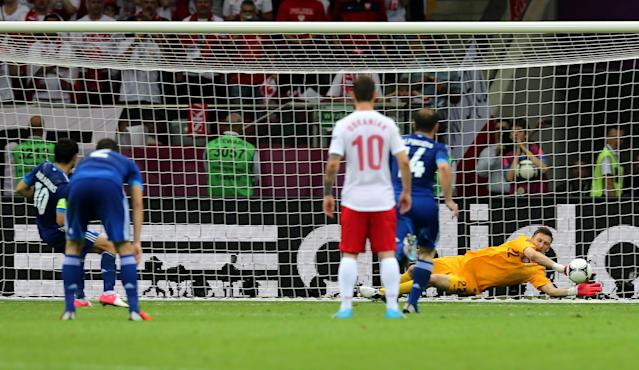 WARSAW, POLAND - JUNE 08: Przemyslaw Tyton of Poland saves Giorgos Karagounis of Greece's penalty during the UEFA EURO 2012 group A match between Poland and Greece at The National Stadium on June 8, 2012 in Warsaw, Poland. (Photo by Alex Grimm/Getty Images)