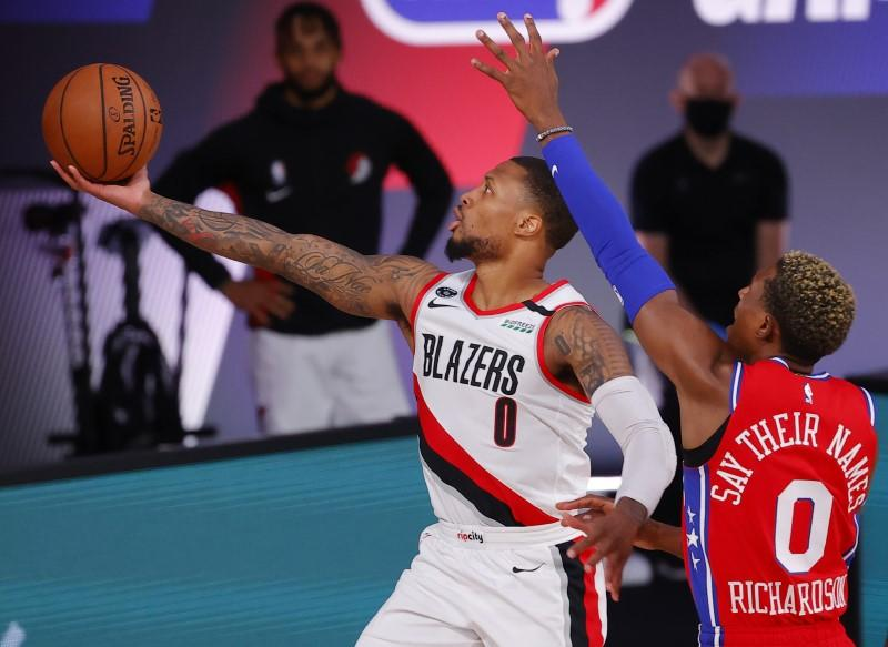 NBA roundup: Lillard scores 51, Embiid injured in Blazers' win