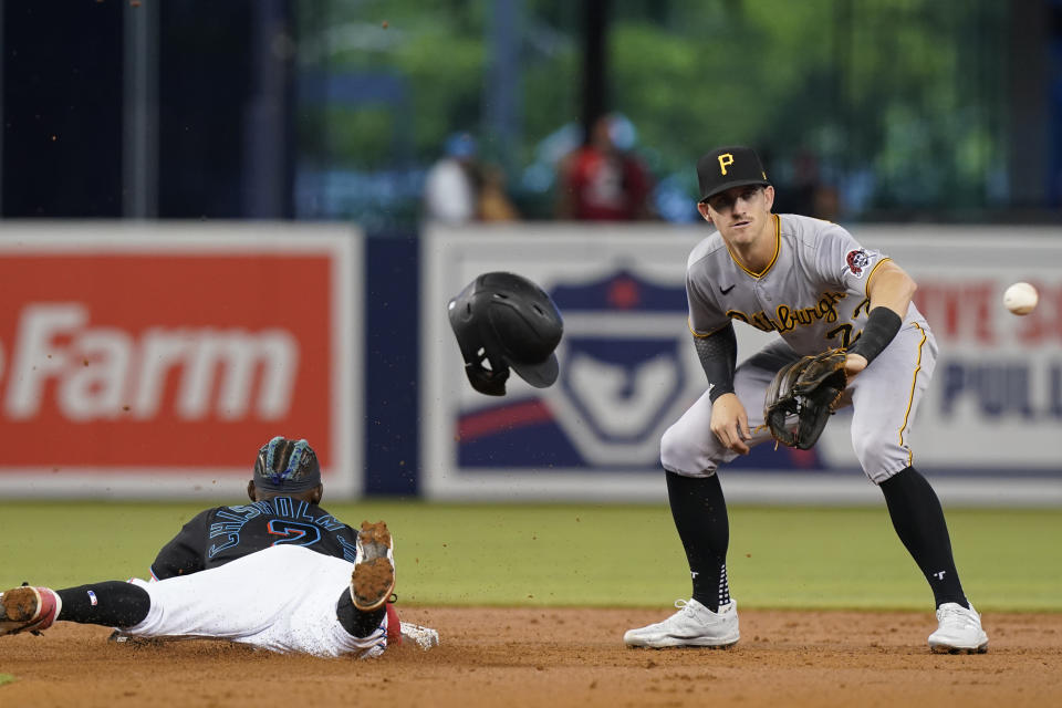 Miami Marlins' Jazz Chisholm Jr. (2) advances to second base on an error on a pickoff throw to first as Pittsburgh Pirates shortstop Kevin Newman (27) waits for the throw during the first inning of a baseball game, Saturday, Sept. 18, 2021, in Miami. (AP Photo/Marta Lavandier)