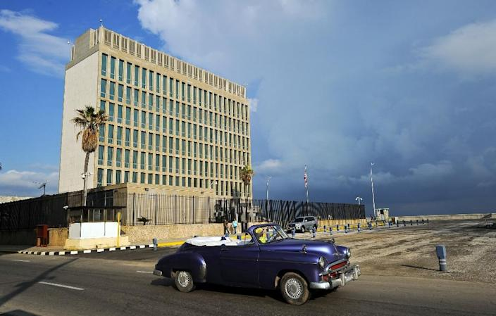 A vintage car drives by the US Embassy in Havana, which Secretary of State Rex Tillerson has said could be closed over alleged sonic attacks on American diplomats (AFP Photo/YAMIL LAGE)