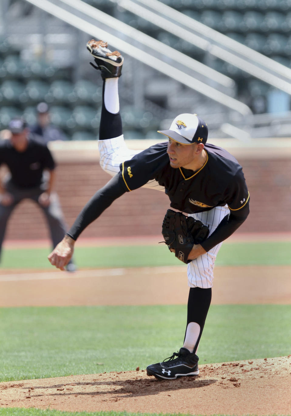 Towson's Mike Volpe follows through on a pitch in the first inning against Florida Atlantic during an NCAA college baseball tournament regional game in Chapel Hill, N.C., Friday, May 31, 2013. Volpe pitched into the eighth inning, giving up one unearned run, as Towson won 7-2. (AP Photo/Ted Richardson)