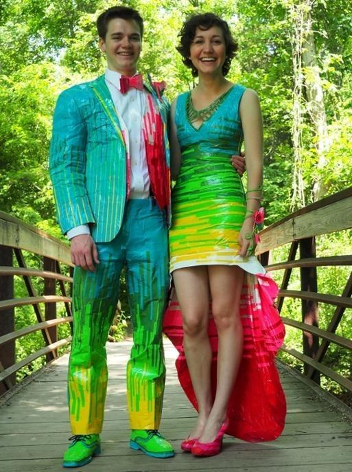 """<p>The couple described their outfits as """"Willy Wonka meets Todd Oldham 80's/early 90's vibe,"""" in their <a href=""""http://stuckatprom.readysetpromo.com/gallery.html?__entry=5918032"""" rel=""""nofollow noopener"""" target=""""_blank"""" data-ylk=""""slk:artists' statement"""" class=""""link rapid-noclick-resp"""">artists' statement</a>. The construction took about 90 hours to complete. (Credit: <a href=""""http://stuckatprom.com/"""" rel=""""nofollow noopener"""" target=""""_blank"""" data-ylk=""""slk:Stuck At Prom"""" class=""""link rapid-noclick-resp"""">Stuck At Prom</a>)<br></p>"""