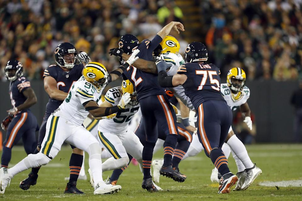 Ouch: Packers Clay Matthews and Julius Peppers crush Bears QB Brian Hoyer; the play broke Hoyer's left arm. (AP)