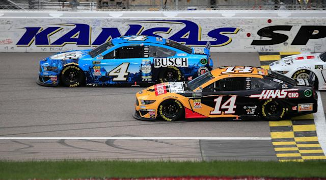 Clint Bowyer (14) ended up finishing ahead of teammate Kevin Harvick. (AP)