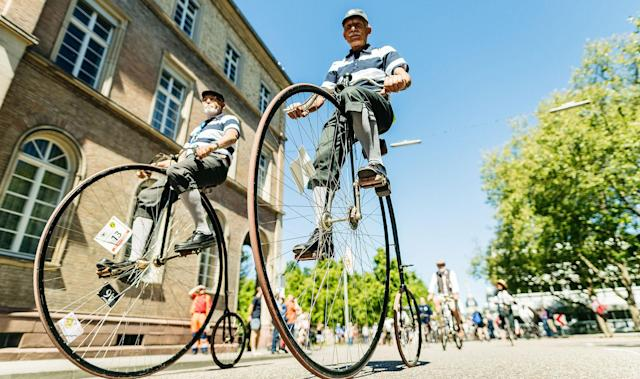 <p>Participants dressed in historical clothing ride high-wheel bicycles during a bicycle ballet event at Schloss Karlsruhe palace during the 2017 International Veteran Cycle Association (IVCA) rally to celebrate the 200th anniversary of the bicycle on May 27, 2017 in Karlsruhe, Germany. Karl Drais, a German inventor, built and tested the first bicycle, called the Draisine, that ran without pedals in 1817. (Photo: Alexander Scheuber/Getty Images) </p>