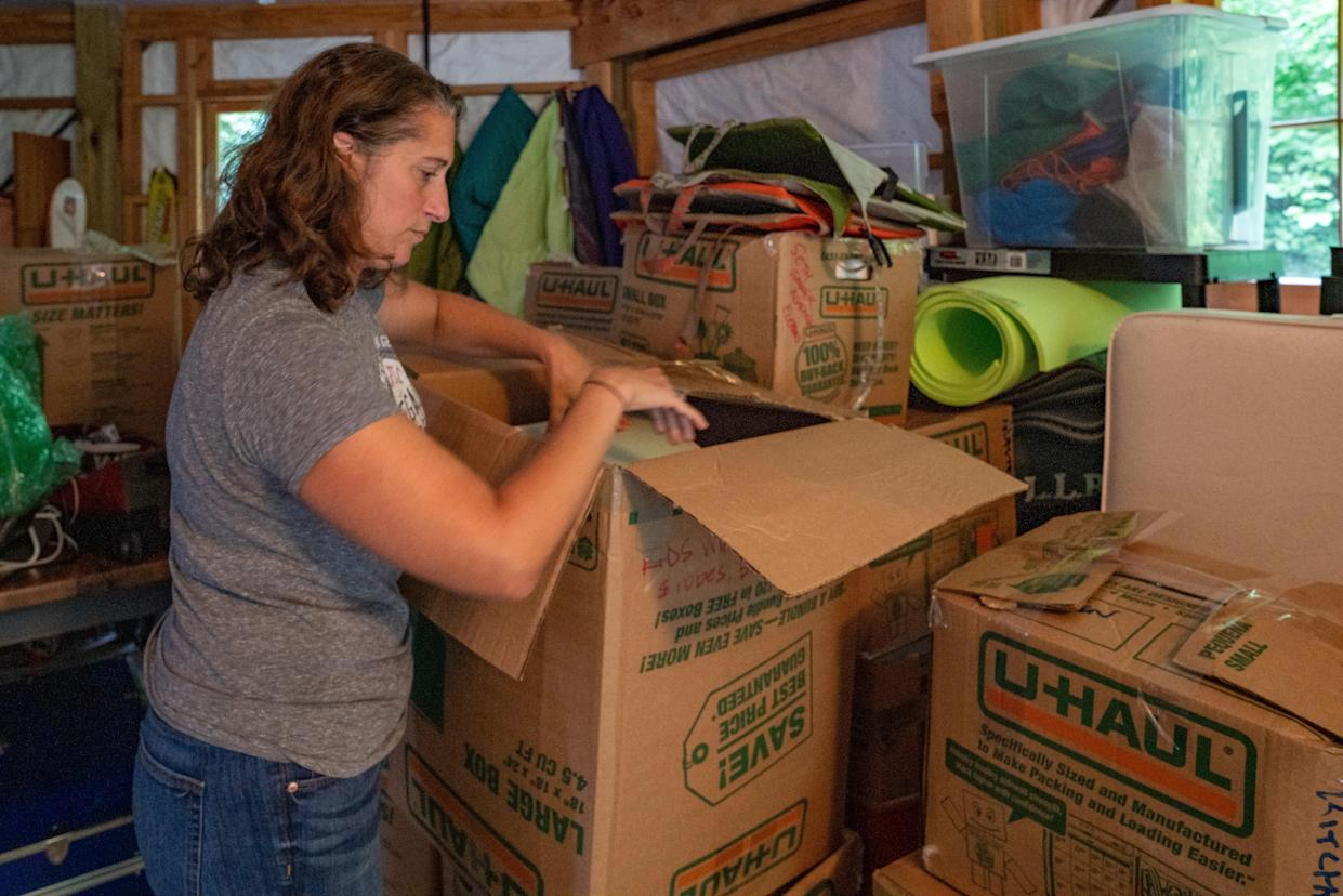 """Kami Lewis Levin packs for her family's move to Costa Rica. (Photo: David """"Dee"""" Delgado for Yahoo News"""