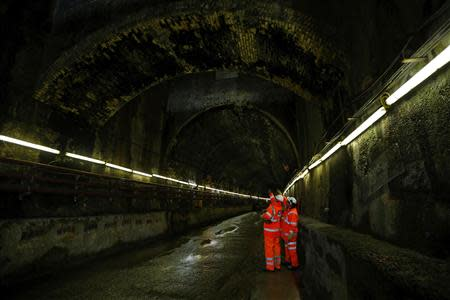 Workers stand inside a Victorian era tunnel which is being reconditioned at Crossrail's Albert Dock site in east London March 13, 2013. REUTERS/Andrew Winning