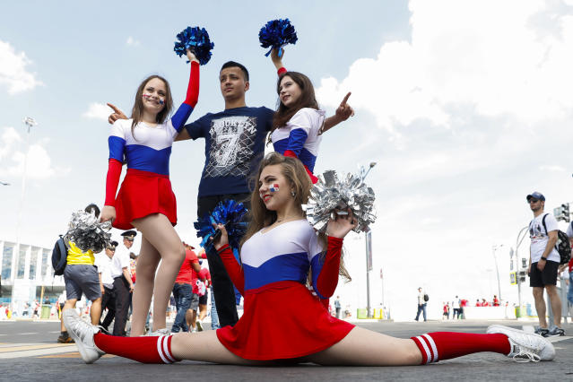 <p>Cheerleaders pose for photos with a soccer fan outside the Nizhny Novgorod Stadium </p>