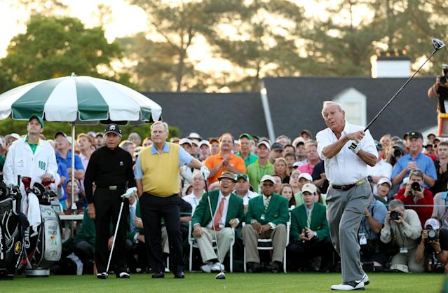 <p>Honorary starter Arnold Palmer hits a tee shot as Gary Player (L) of South Africa and Jack Nicklaus (C) stand on the tee box at the start of the first round of the 2012 Masters Tournament at Augusta National Golf Club on April 5, 2012 in Augusta, Georgia. (Photo by Andrew Redington/Getty Images) </p>