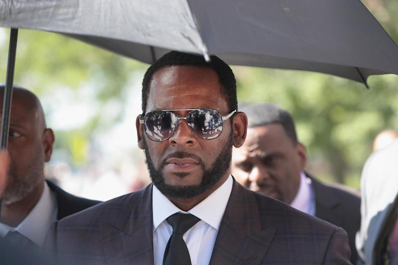 R. Kelly leaves a court hearing in Chicago. The embattled singer's trial is finally approaching. (Scott Olson/Getty Images)