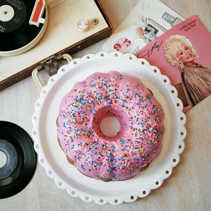 """<p>If your mom loves Dolly as much as we do, perhaps she'd appreciate this homage to the Queen of Country, from Brooklyn's <a href=""""https://bakednyc.com/"""" rel=""""nofollow noopener"""" target=""""_blank"""" data-ylk=""""slk:Baked"""" class=""""link rapid-noclick-resp"""">Baked</a>. It's a giant donut-like glazed cake packed with <a href=""""https://www.countryliving.com/food-drinks/a34223656/dark-chocolate-coconut-filling/"""" rel=""""nofollow noopener"""" target=""""_blank"""" data-ylk=""""slk:dark chocolate coconut filling"""" class=""""link rapid-noclick-resp"""">dark chocolate coconut filling</a> and covered in a <a href=""""https://www.countryliving.com/food-drinks/a34223745/simple-coconut-glaze/"""" rel=""""nofollow noopener"""" target=""""_blank"""" data-ylk=""""slk:simple coconut glaze"""" class=""""link rapid-noclick-resp"""">simple coconut glaze</a>.</p><p><strong><a href=""""https://www.countryliving.com/food-drinks/a34222825/dollys-donut-coconut-bundt-cake/"""" rel=""""nofollow noopener"""" target=""""_blank"""" data-ylk=""""slk:Get the recipe"""" class=""""link rapid-noclick-resp"""">Get the recipe</a>. </strong></p><p><a class=""""link rapid-noclick-resp"""" href=""""https://www.amazon.com/Nordic-Ware-Cast-Original-Bundt/dp/B000HM9UDO/?tag=syn-yahoo-20&ascsubtag=%5Bartid%7C10050.g.3185%5Bsrc%7Cyahoo-us"""" rel=""""nofollow noopener"""" target=""""_blank"""" data-ylk=""""slk:SHOP BUNDT PANS"""">SHOP BUNDT PANS</a><br></p>"""