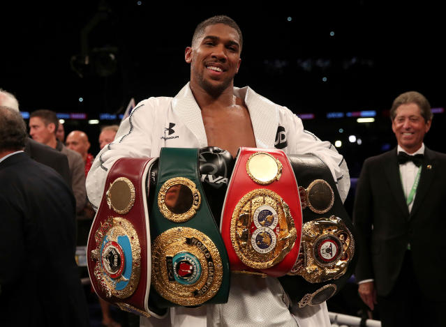 Anthony Joshua holds the IBF-WBA-WBO championship heavyweight belts. (AP)